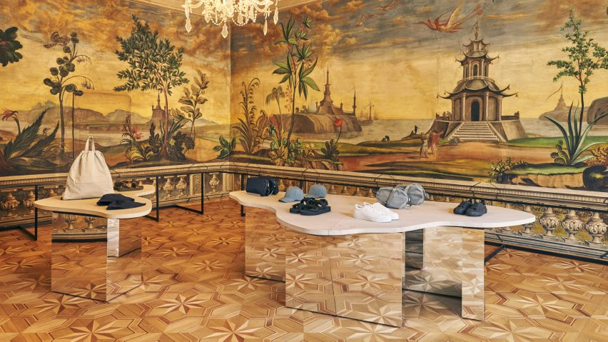 Mirrored display tables with stone tops in COS Bolzano store