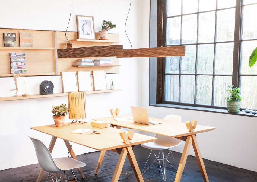 Dash Linear lighting by Graypants hangs over an office workbench