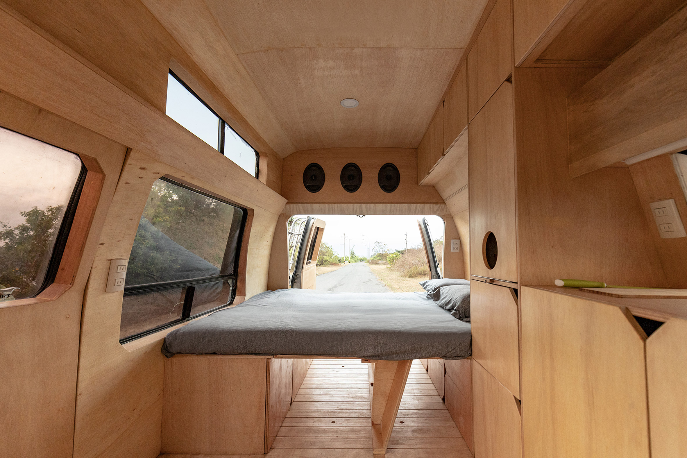 A grey mattress inside a mobile home