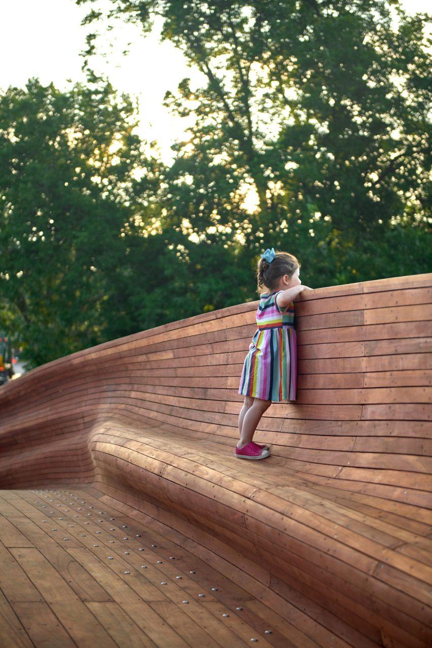 Girl standing on wooden bridge