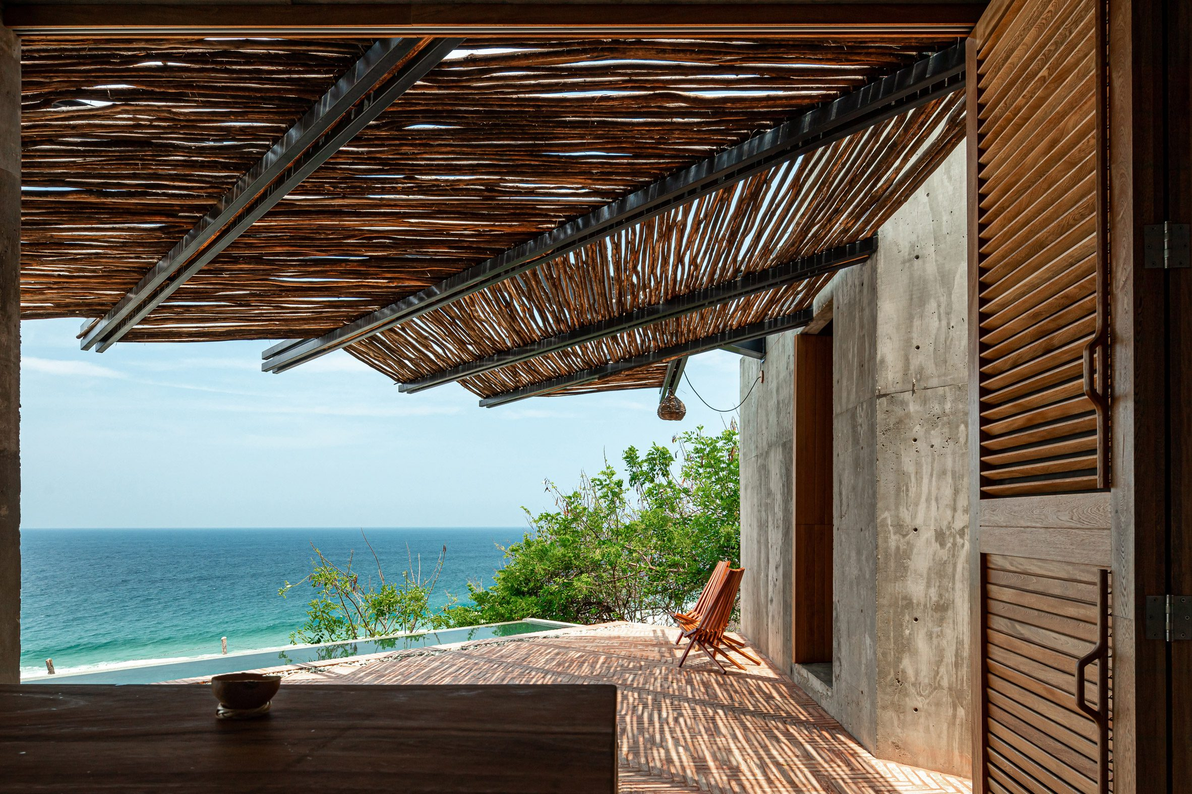 A chair on a deck overlooking the sea