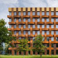 Sergei Tchoban uses Corten steel to create huge basket-weave facade