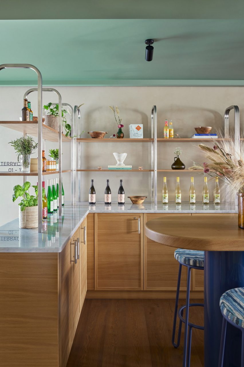 Wood and marble bar in hotel interior by Fettle