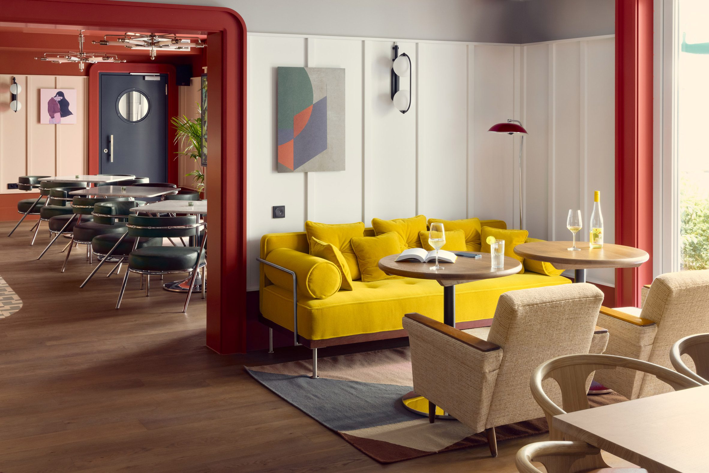 Yellow sofa in hotel interior by Fettle against white wall panels