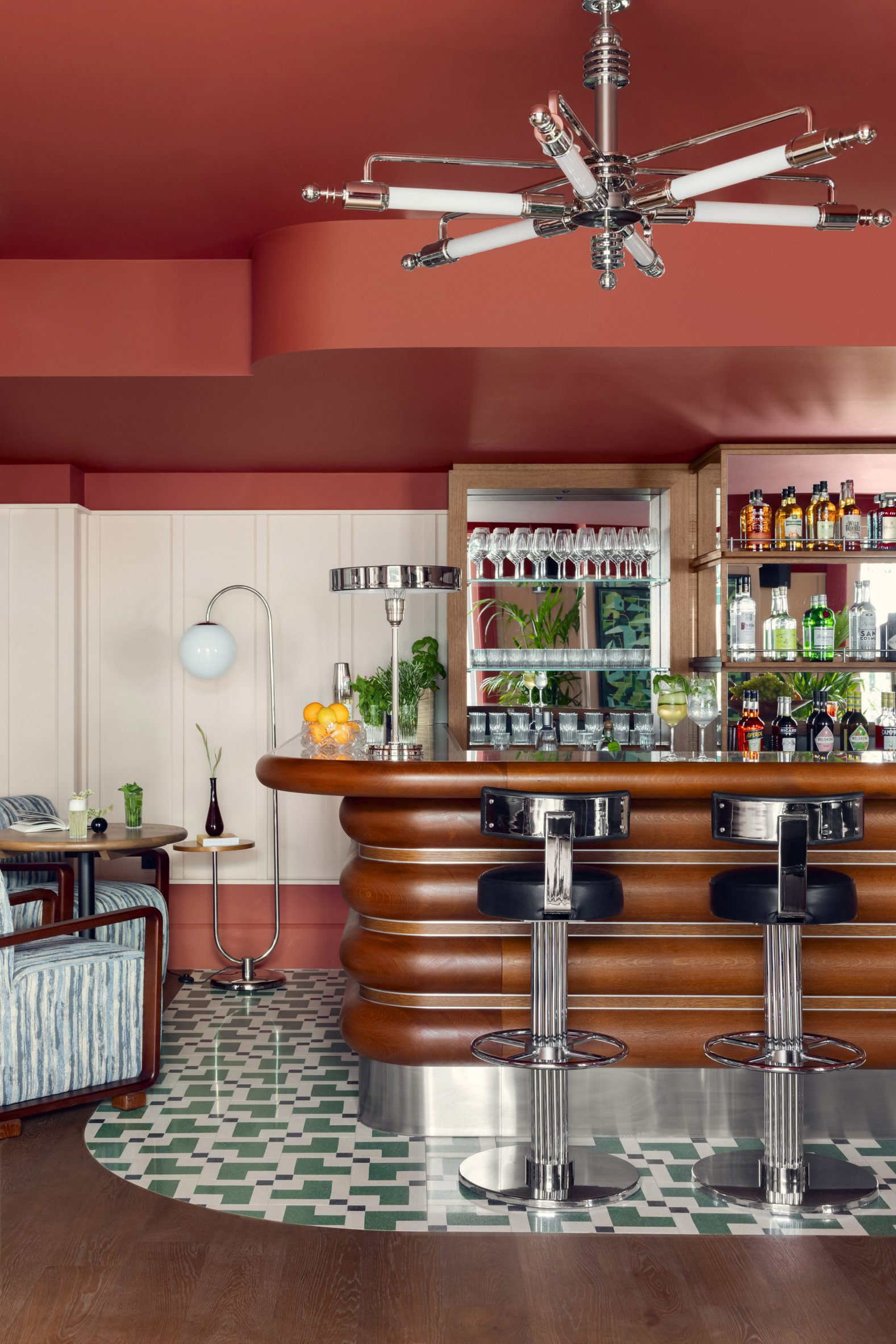 Curved wooden bar and patterned floor in Schwan Locke hotel
