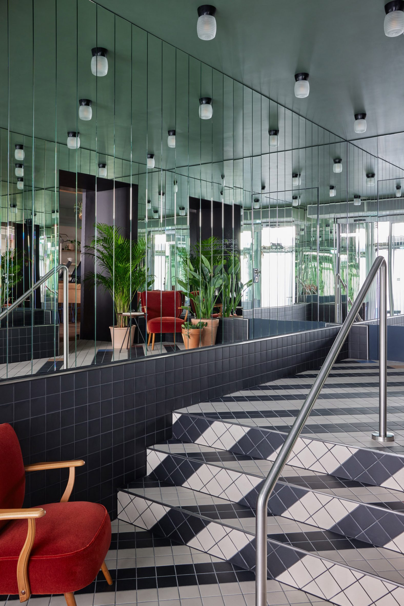 MIrrored walls and black and white patterned floors in Schwan Locke hotel