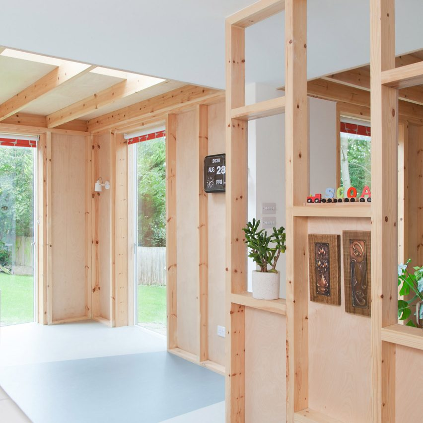 A kitchen with wooden partitions