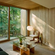 Garrison Architects completes modernist Catskills retreat with 24 elevated cabins