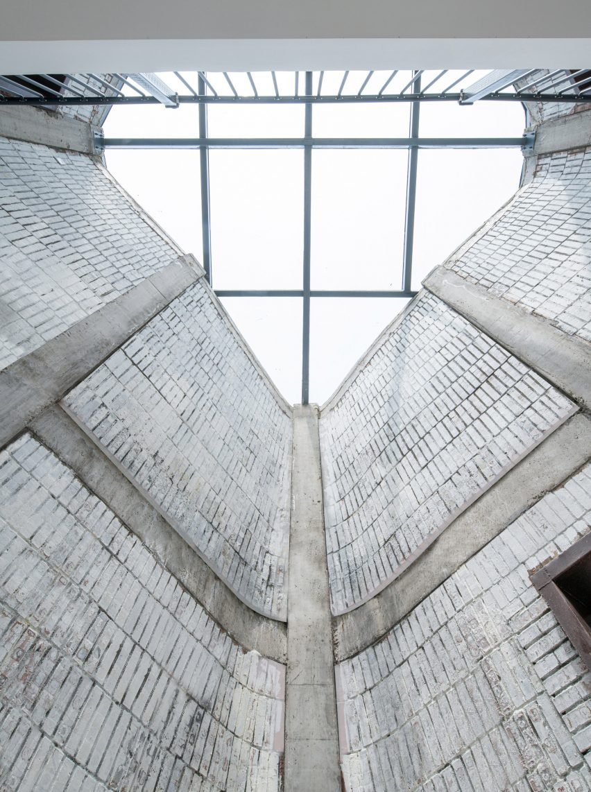 Brick-clad interior lightwell in pods of Grotto Retreat Xiyaotou