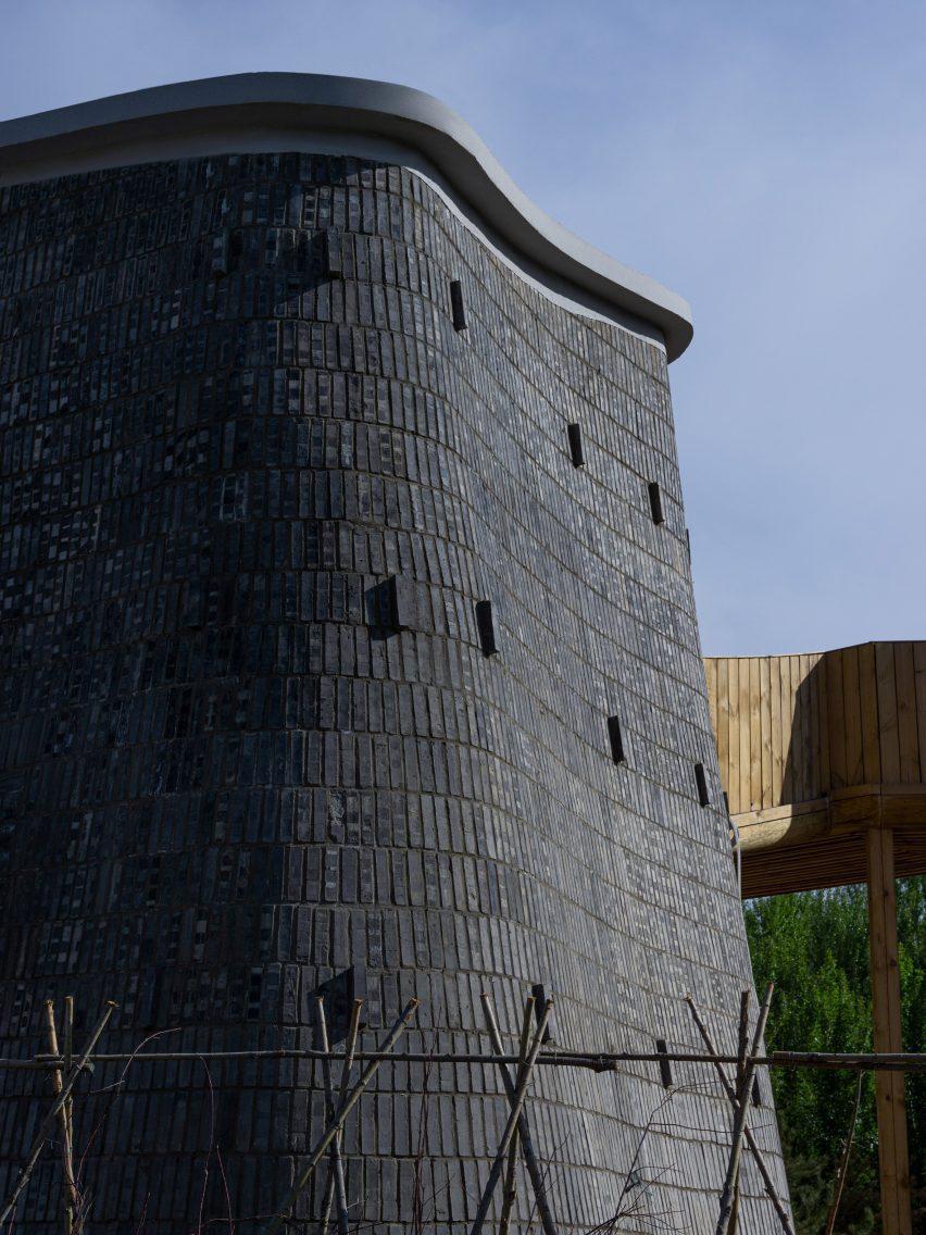Vertical pod clad in dark grey bricks in Grotto Retreat Xiyaotou