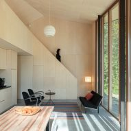 Holiday Home by Orange Architects is a timber-clad cabin with a flexible interior