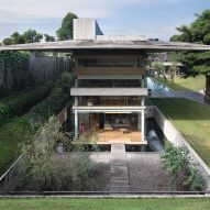 Giant concrete roof shelters home in Indonesia by Andramatin