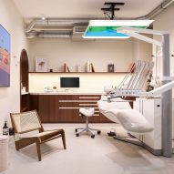 A dentist's room with white floor and brown counters