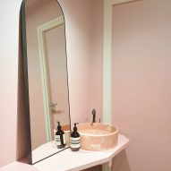 A pink bathroom and mirror