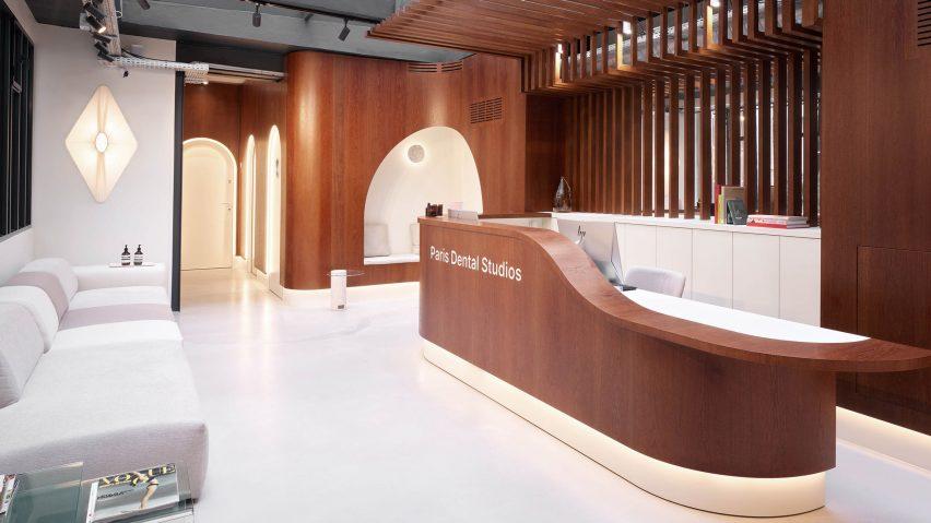 Lobby and oak reception desk inside Paris Dental Studios