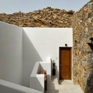 Kyriakos Tsolakis Architects blends resort for athlete rehabilitation into Mykonos hillside