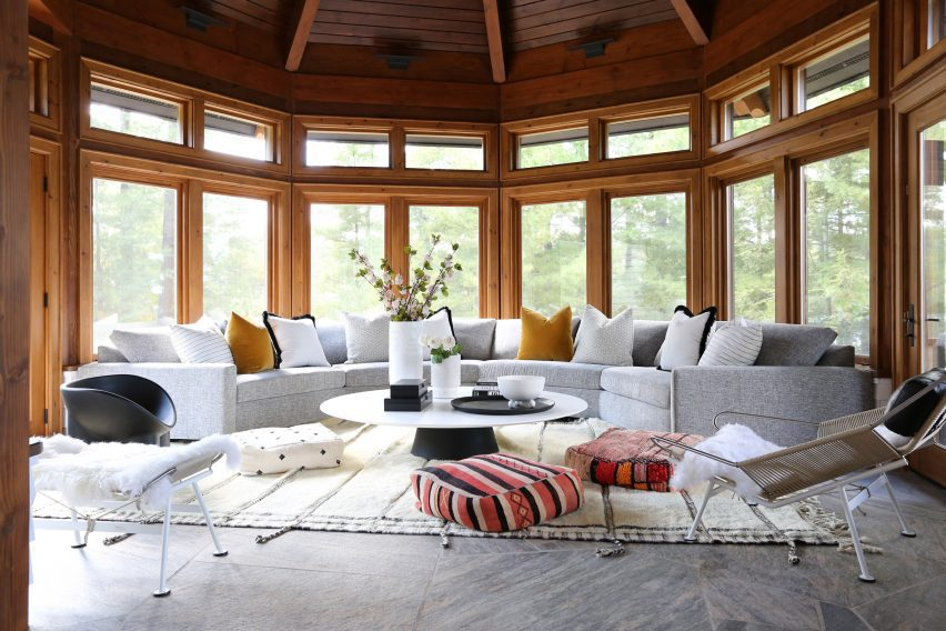 Muskoka cottage by Ali Budd Interiors has wooden window frames