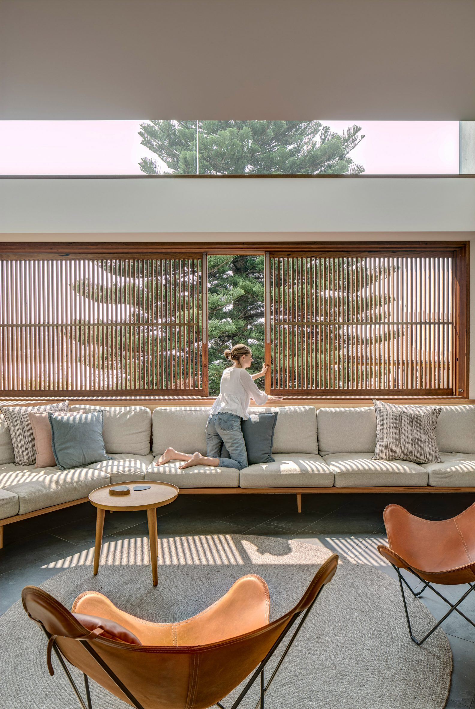 Slatted shutters line the living room windows in this Australian house