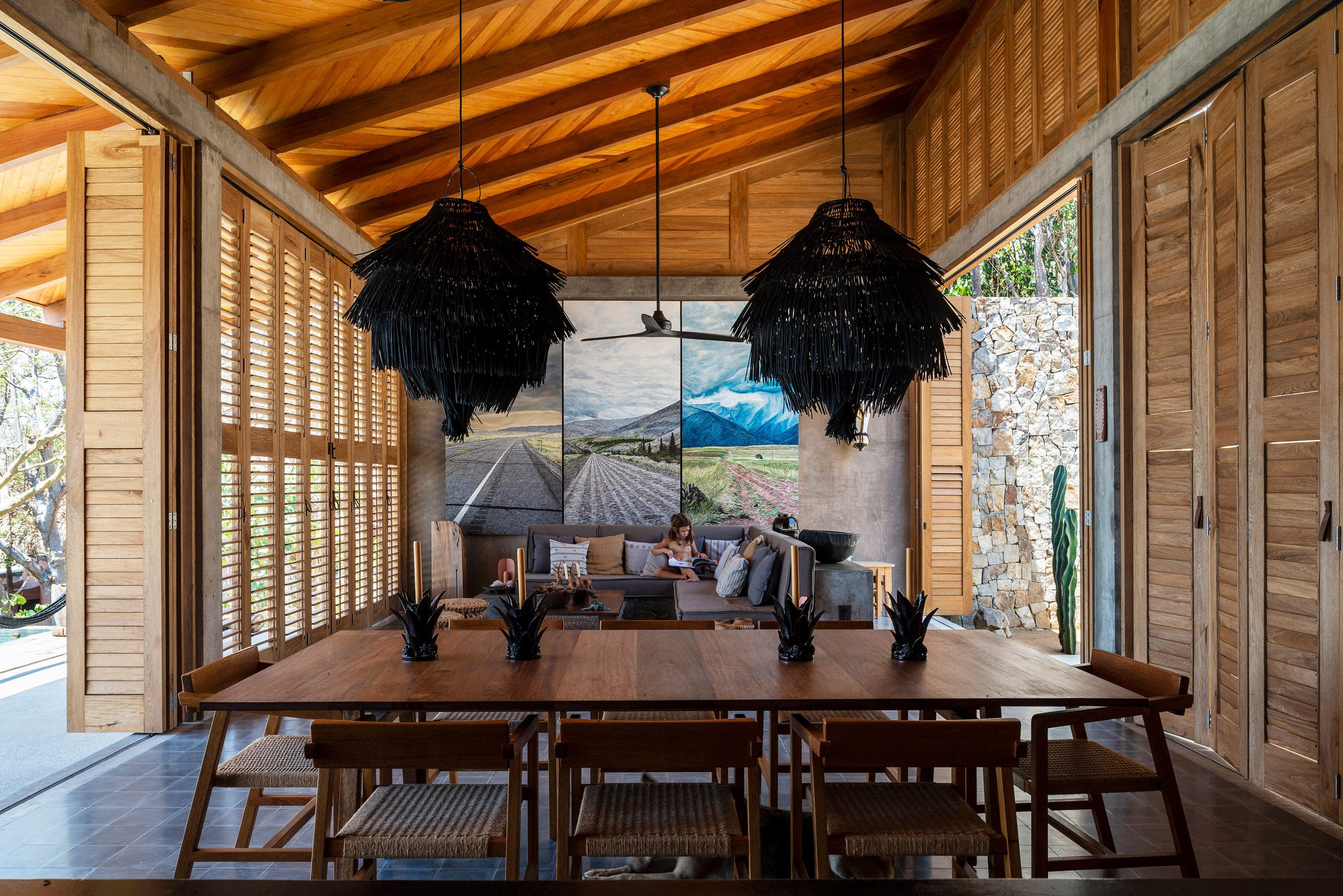 Wooden shutters flank this living room