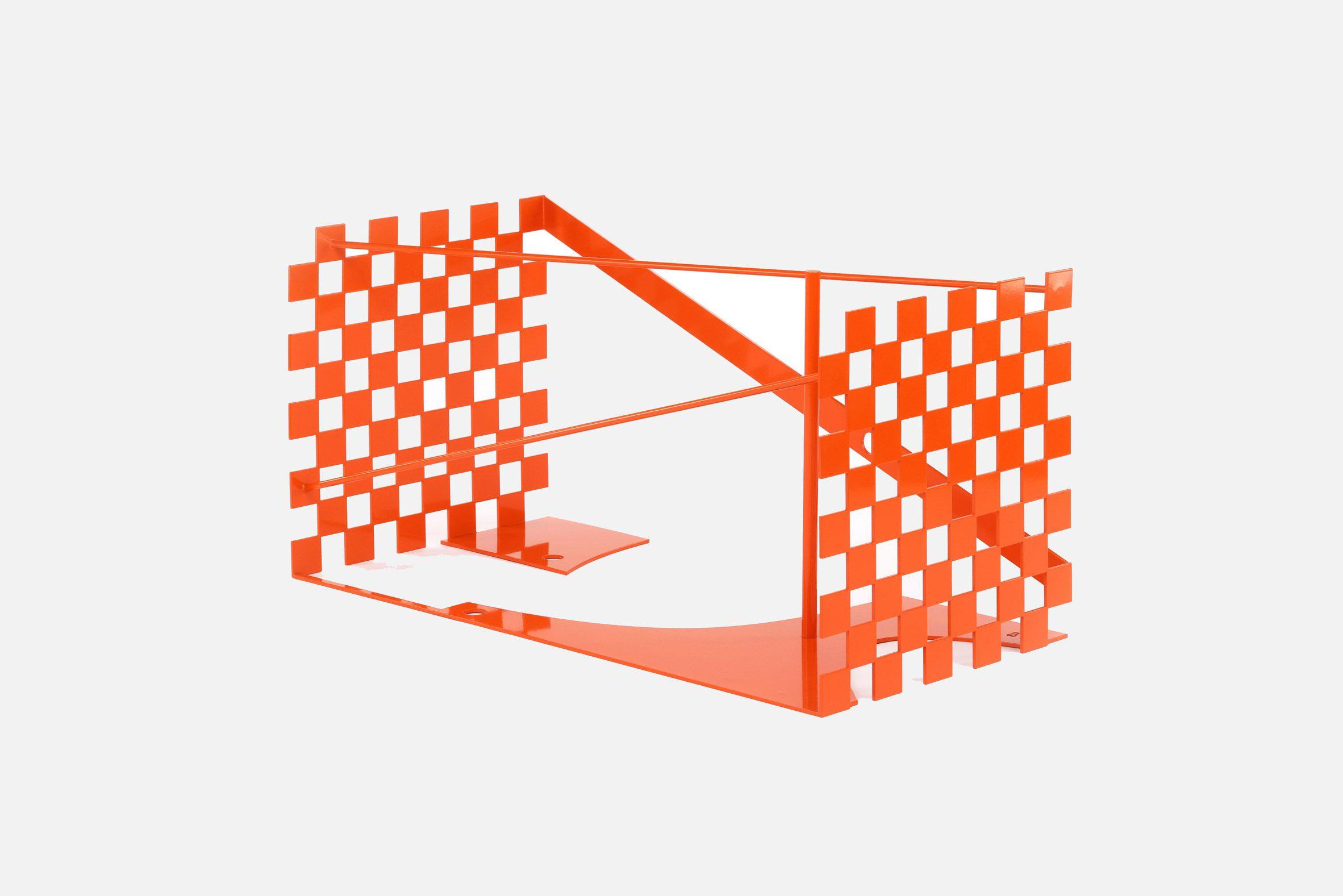 An orange trunk designed by Samuel Ross