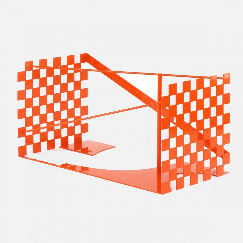 An orange metal Louis Vuitton trunk design