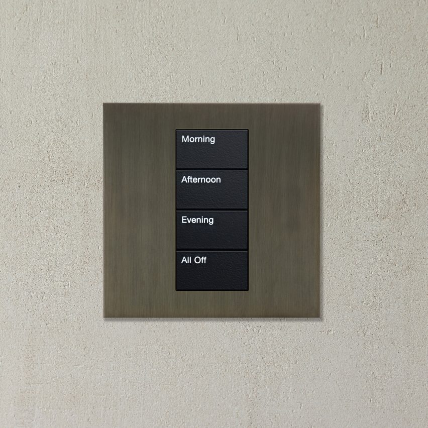 A metal lighting control with four switches: morning, afternoon, evening and all off