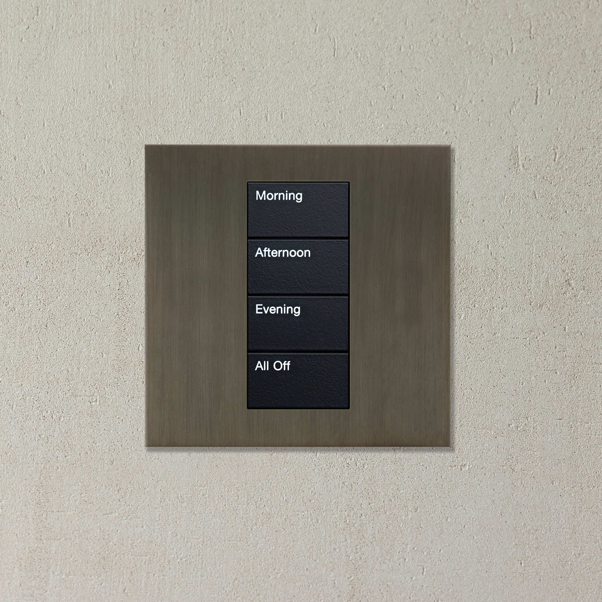 A metallic lighting control with four switches: morning, afternoon, evening and all off