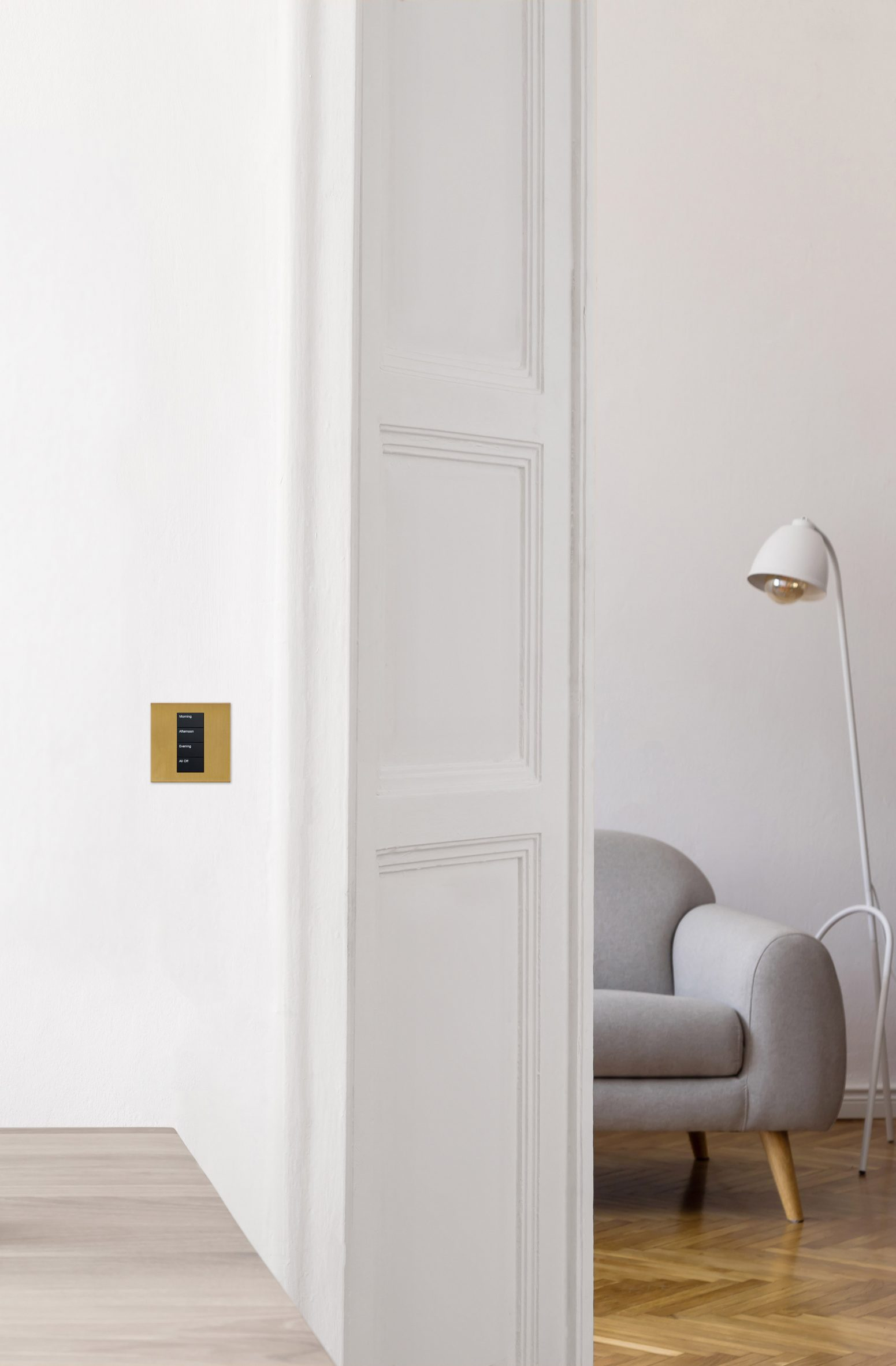 gold light control in a neutral, white interior