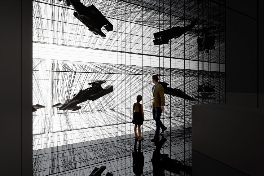 Black room with immersed installations showing carbon fiber objects