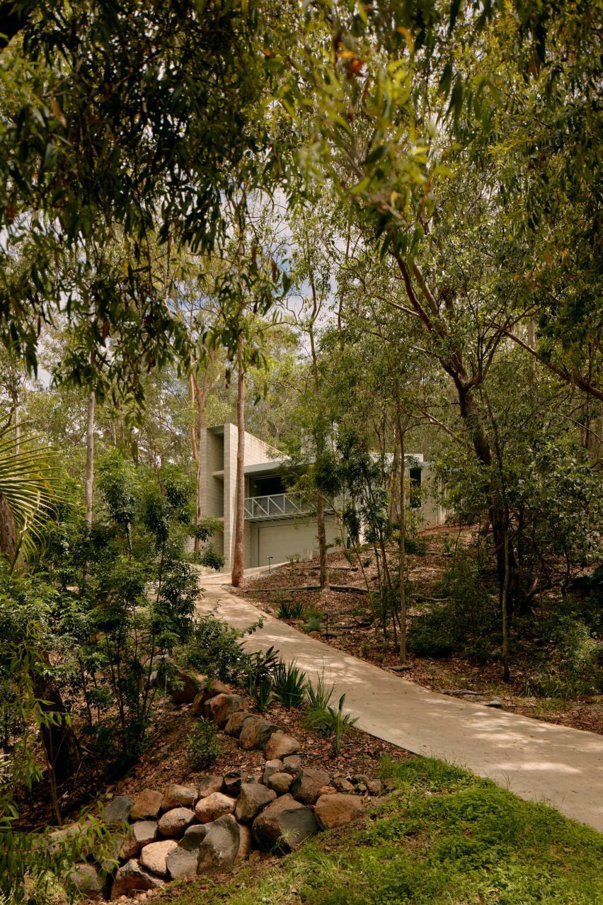 Driveway leading up to Mt Coot-Tha House with triple-height concrete staircase block