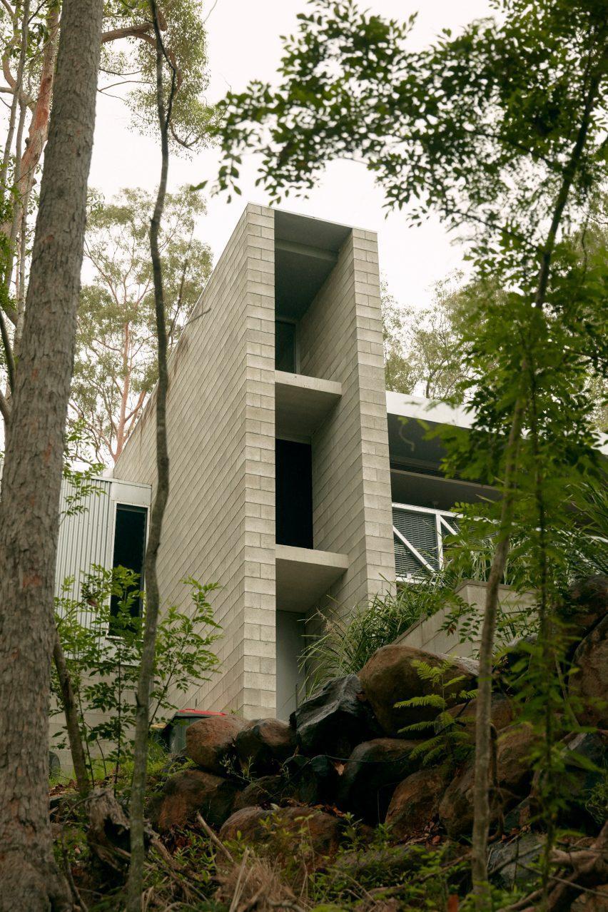 Triple-height concrete staircase block in Brisbane house by Nielsen Jenkins