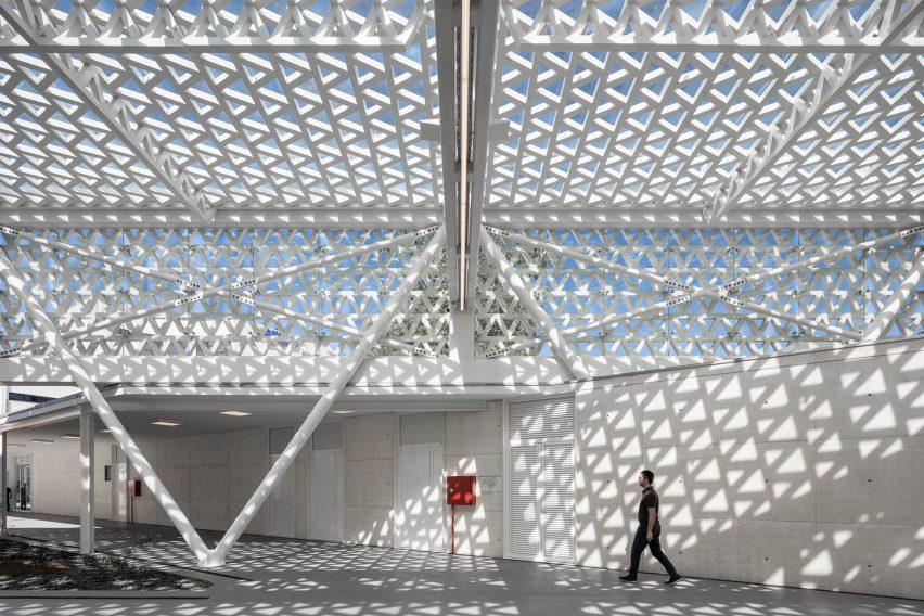 Triangular shadows are cast across the interior of the municipal market famalicao