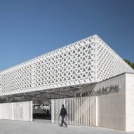 Triangular-patterned canopy shelters stalls at modernised Portuguese marketplace