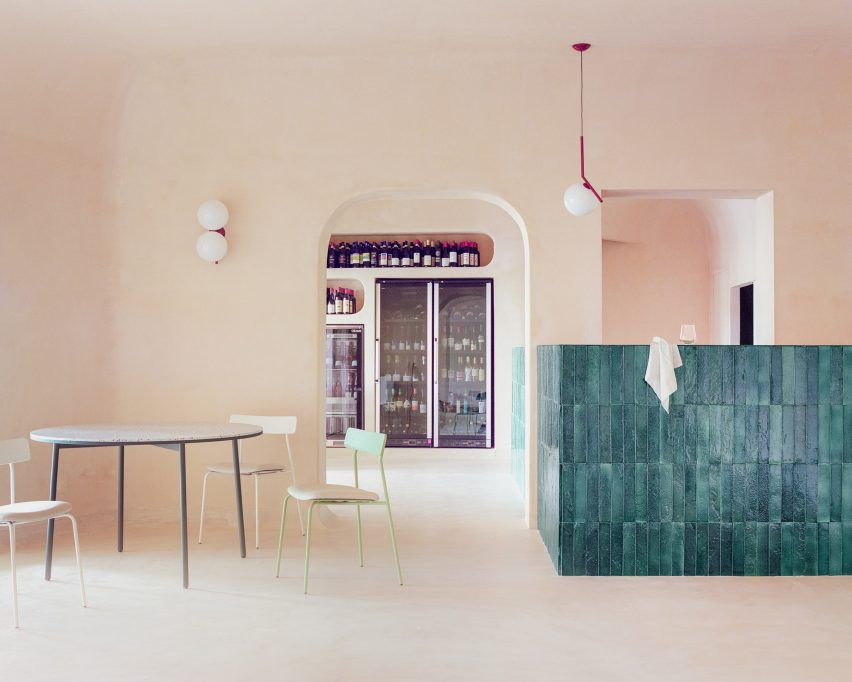 Green tiled counter next to seating area with views to wine fridge in Myrto pizzeria