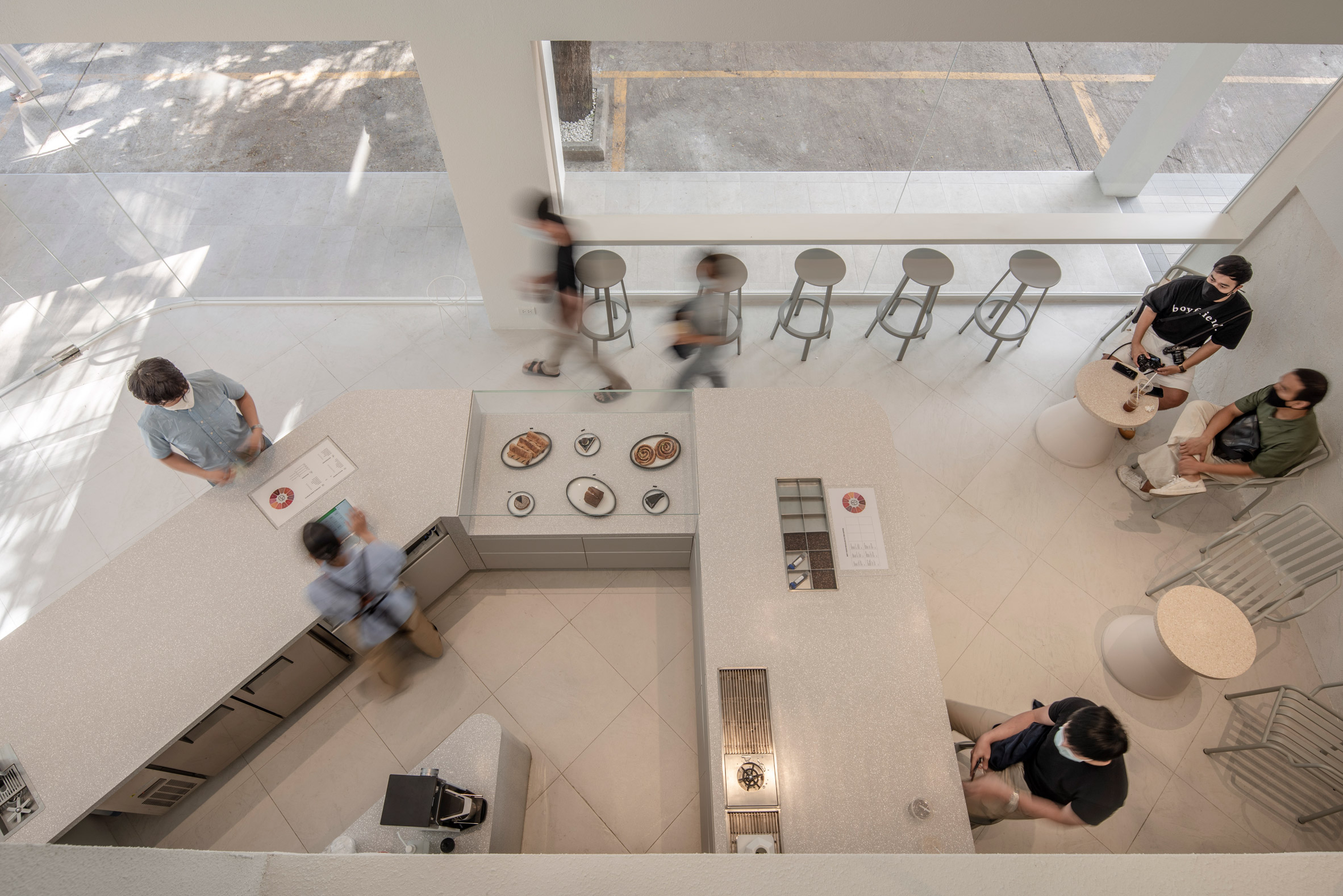 People sitting in a white cafe
