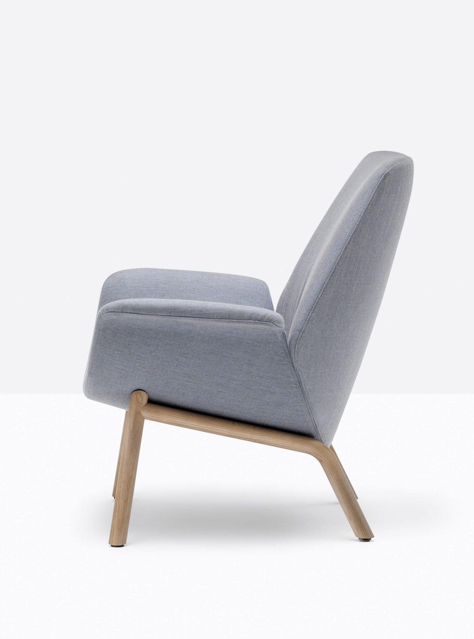 A photo of a grey armchair