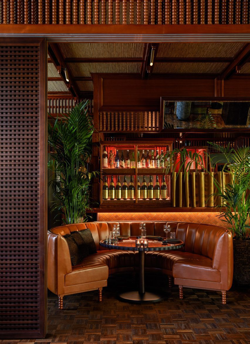 Curved leather bench in front of bar with wooden joinery in Mimi Kakushi restaurant