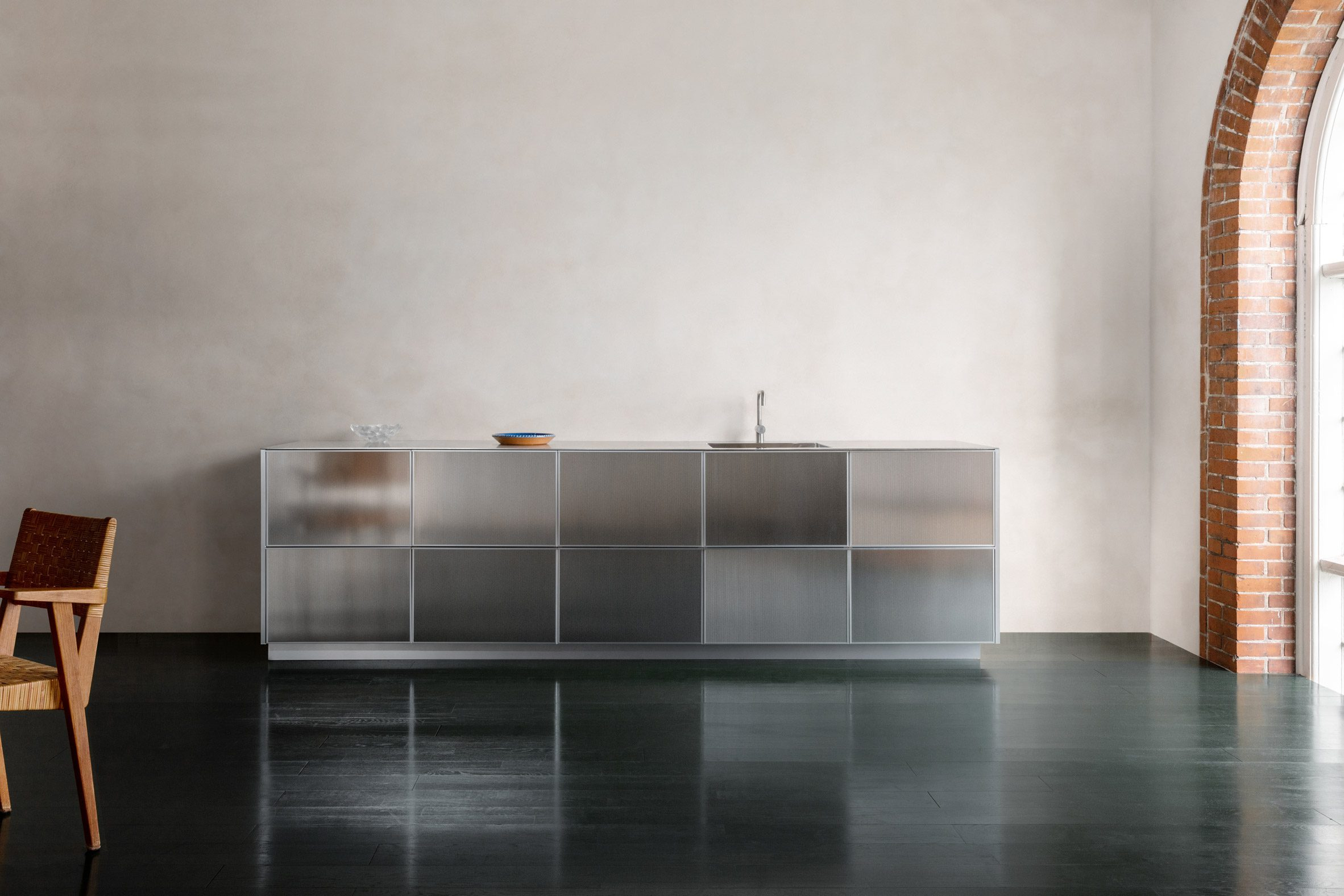 A photograph of a kitchen that reflects light
