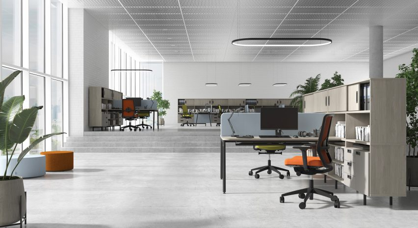 Office with desks arranged in twos and separated by a central privacy screen