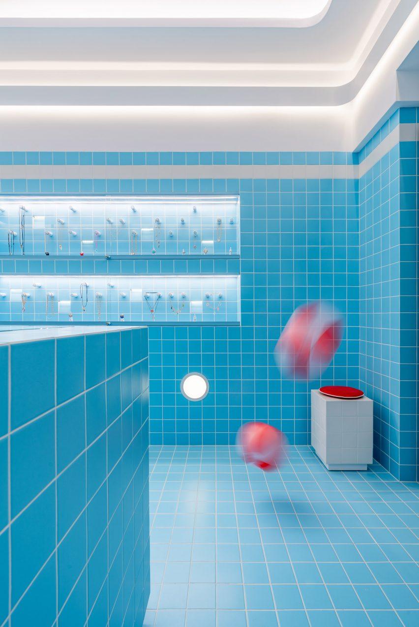 beach balls bouncing inside a blue store