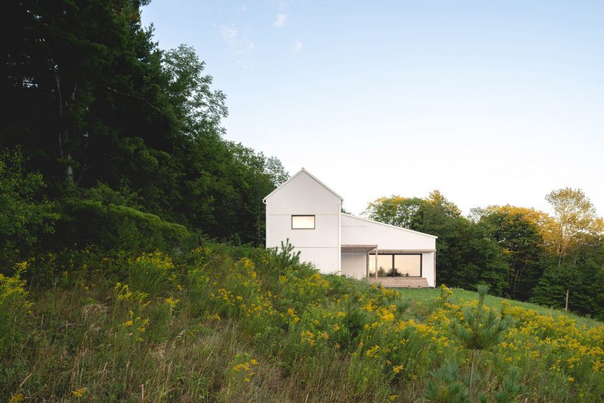 House nestled into sloping site