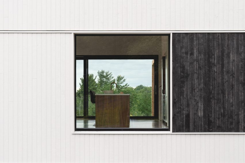 White wood exterior with burnt cedar panel