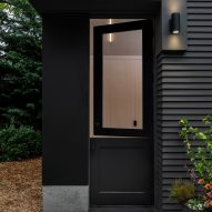 A black door at the entrance of the gym and office space