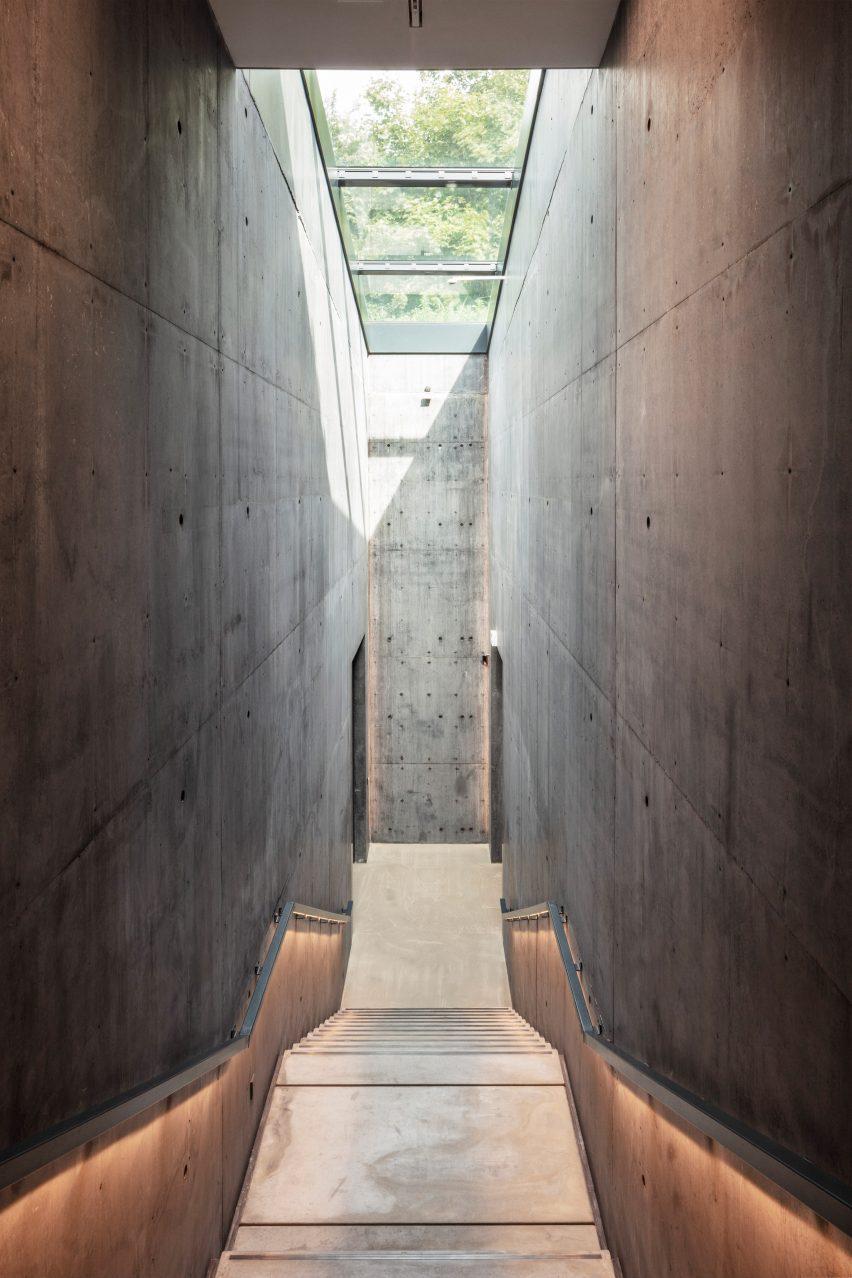 Snohetta Ordrupgaard Museum interior with dark concrete palette