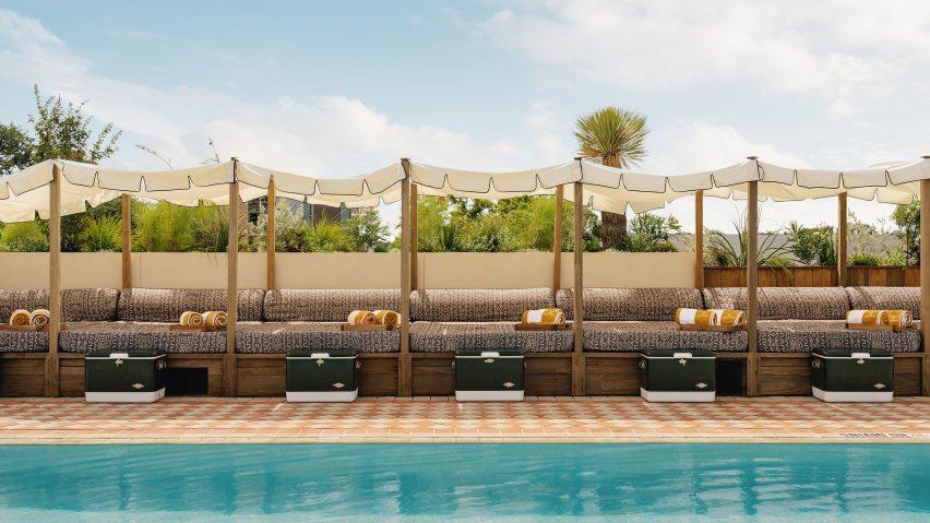 Loungers alongside swimming pool