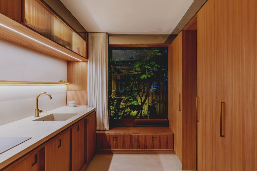 The kitchen feels like a self-contained unit crafted entirely from elm