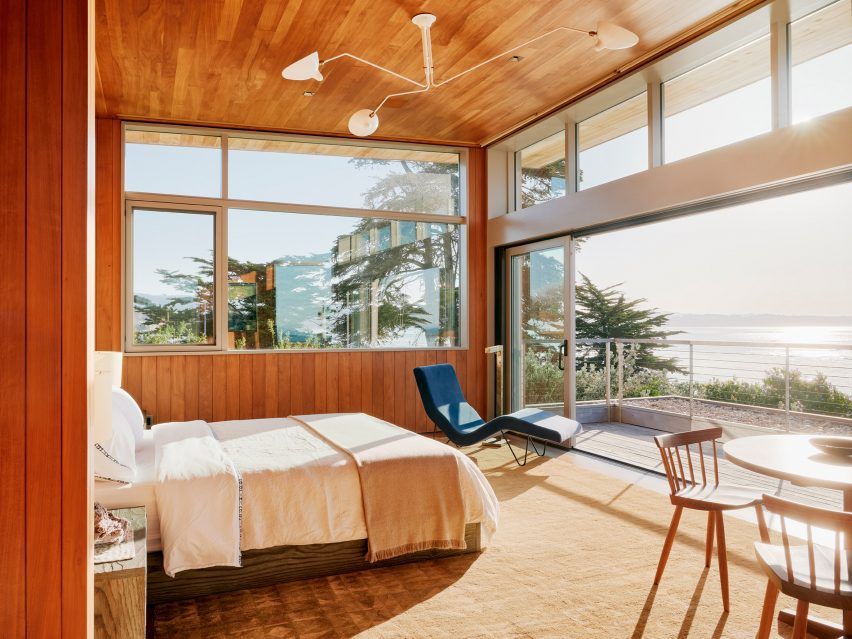 Throughout the dwelling, rooms are adorned with earthy materials and contemporary decor