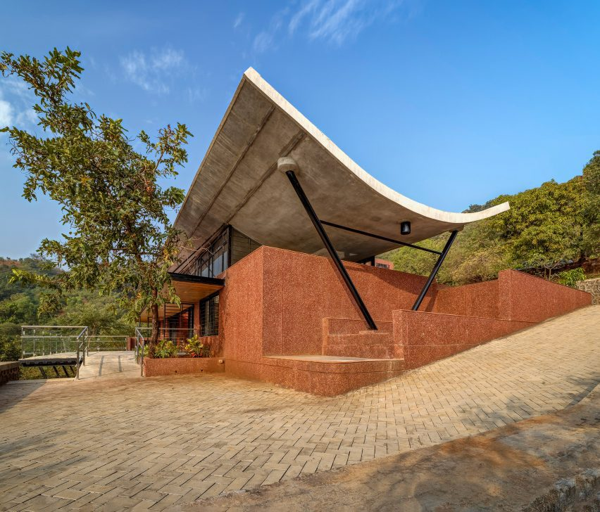 Red brick exteriof of The Cove House in the Western Ghats mountains