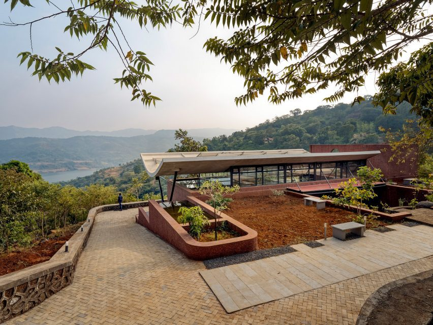 A brick house overlooking the Western Ghats mountain range