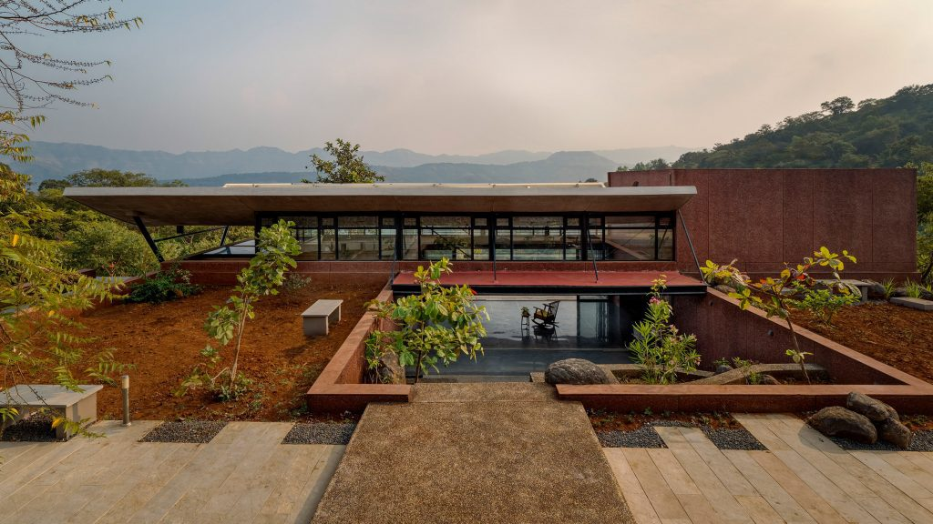 Curved roof tops weekend retreat near Pune by Red Brick Studio